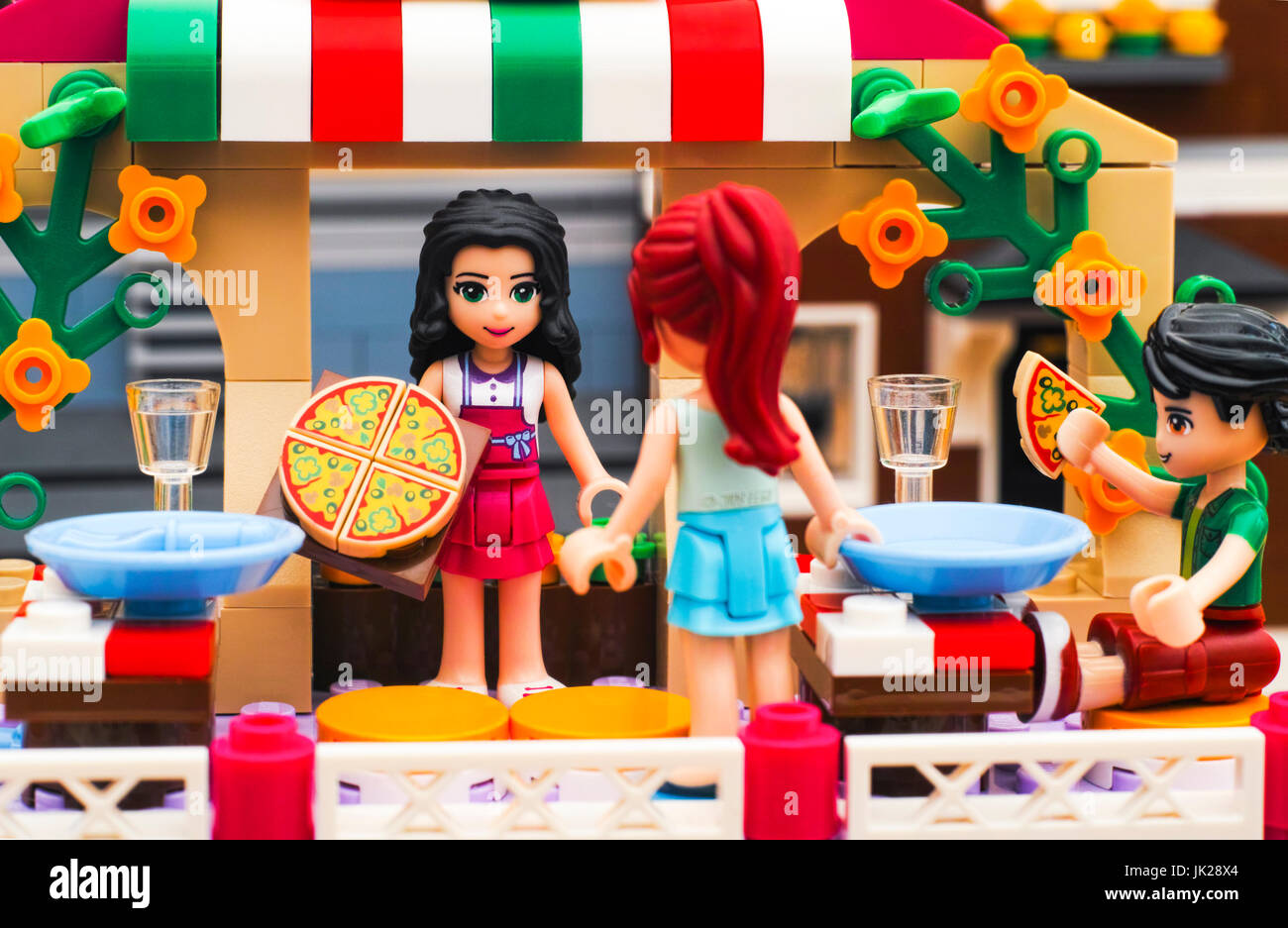 Tambov, Russian Federation - June 22, 2017 Lego Pizzeria. Waitress serves pizza for guests in restaurant. Studio - Stock Image