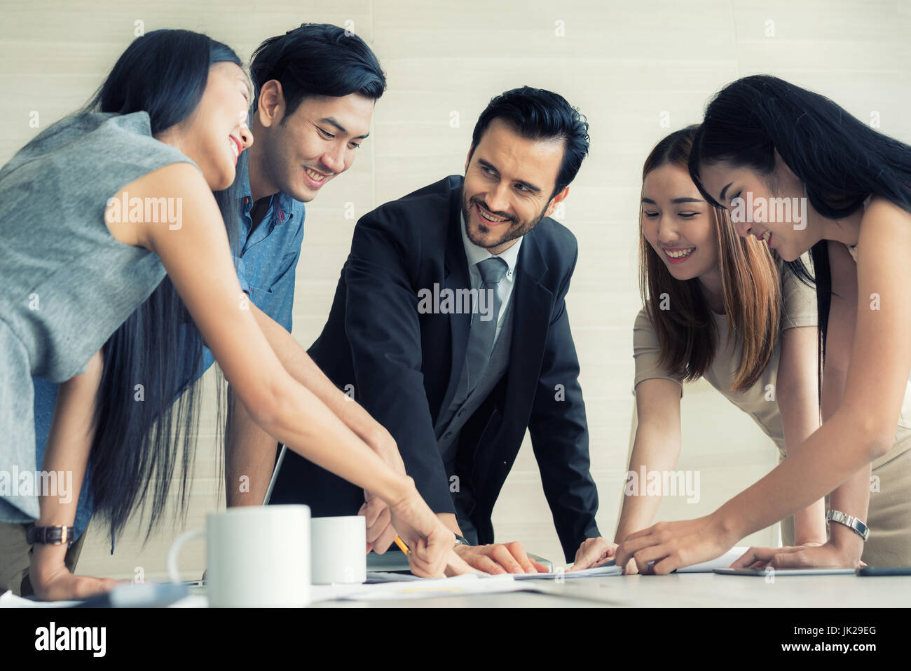 Group of multi-ethnic business partners discussing ideas in meeting room at office. Business people meeting corporate - Stock Image