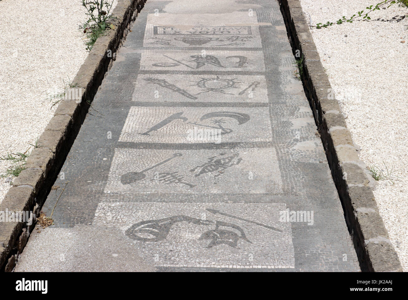 OSTIA ANTICA, ITALY -  JULY  2, 2017: Mithraeum steps to enlightenment an ancient Roman Mosaic Floor in a Mithraic - Stock Image