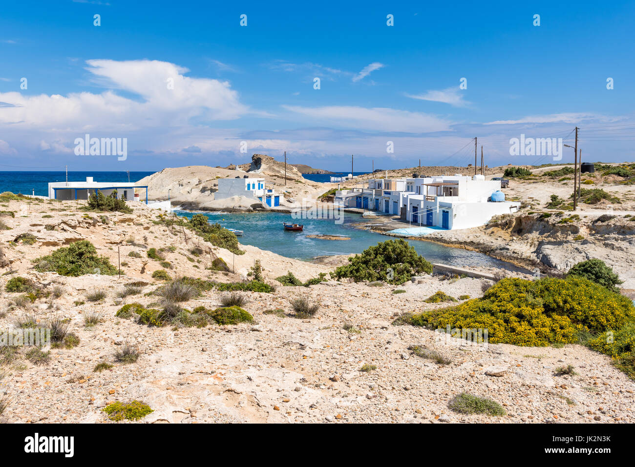 Small and quiet seaside settlement of Agios Konstantinos on island of Milos. Cyclades, Greece. - Stock Image