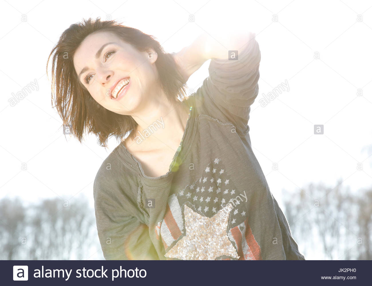 Portrait woman having fun outdoor in the sun - Stock Image