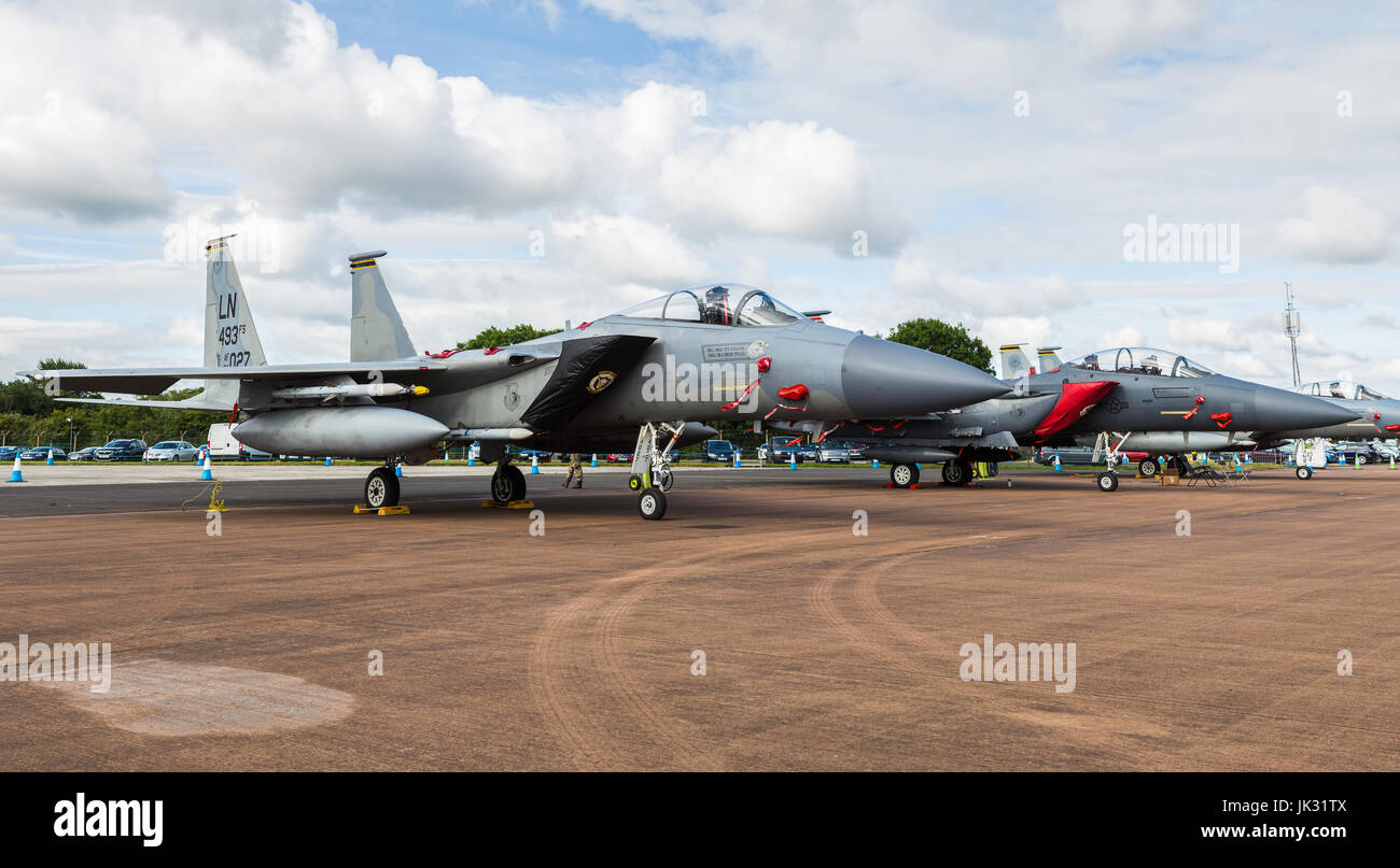 F-15E Strike Eagle sat between a pair of F-15C Eagles at the 2017 Royal International Air Tattoo at RAF Fairford. Stock Photo