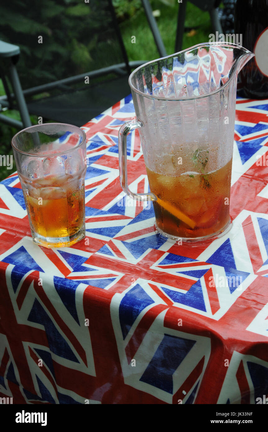 Union Jack table cloth and a jug of Pimms, at the 2017, Chap Olympiad. - Stock Image
