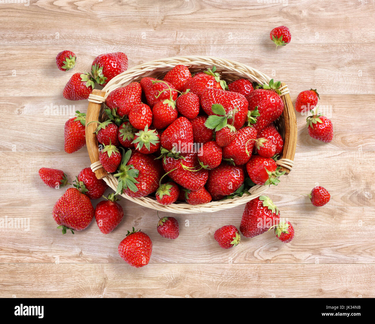 Fresh strawberry in basket on wooden background. Top view. High resolution. Harvest concept Stock Photo