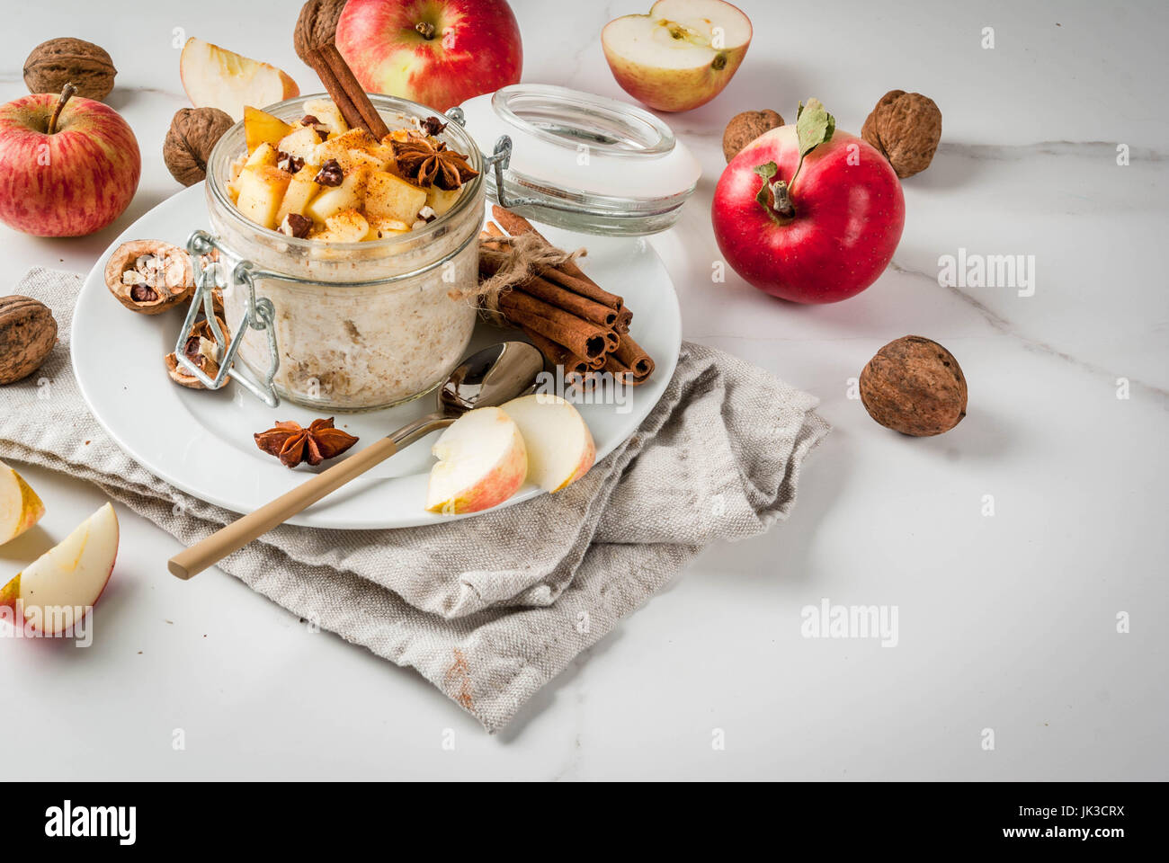 Healthy vegan food. Dietary breakfast or snack. Apple pie overnight oats, with apples, yogurt, cinnamon, spices, - Stock Image