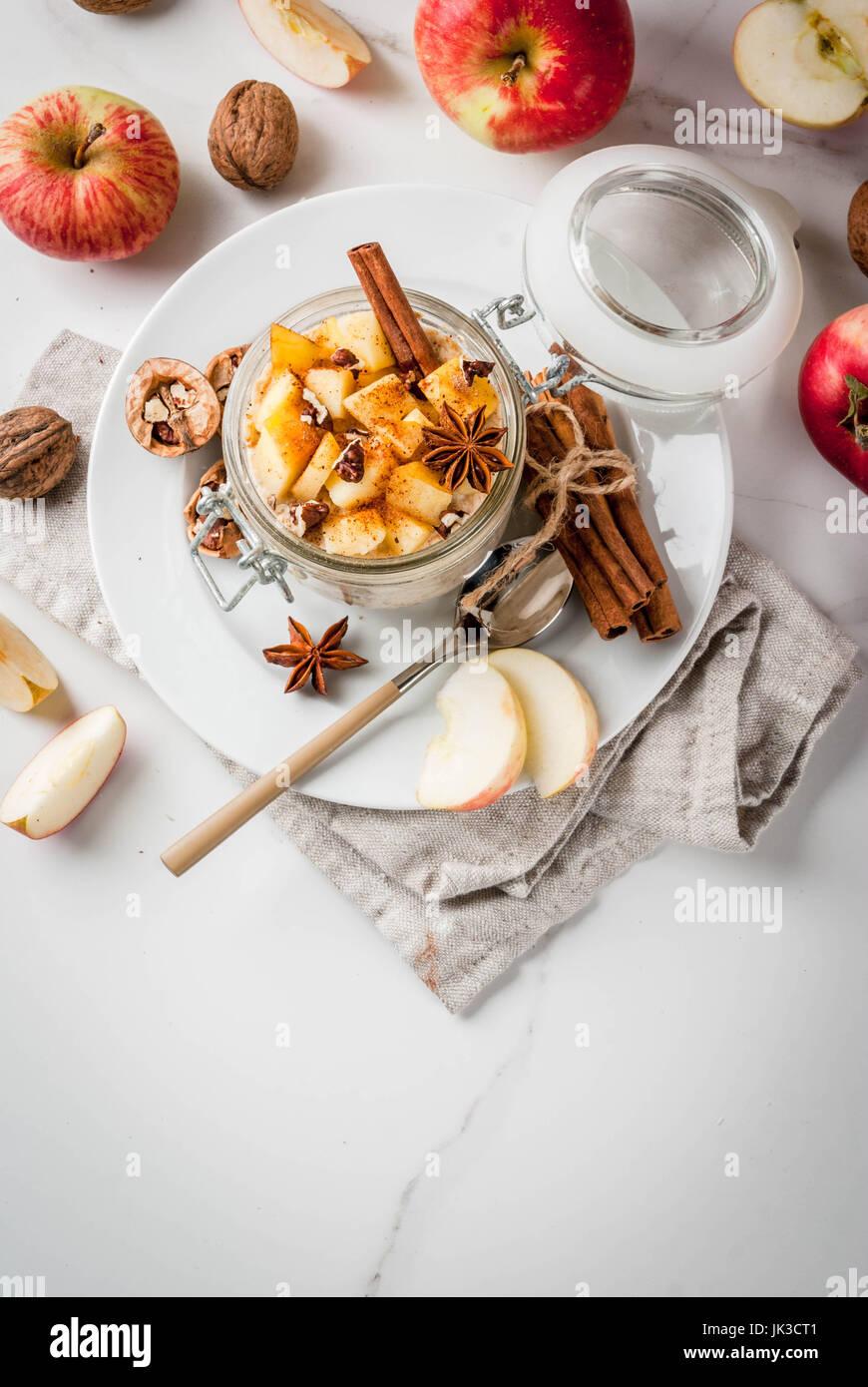 Healthy vegan food. Dietary breakfast or snack. Apple pie overnight oats, with apples, yogurt, cinnamon, spices, - Stock Image