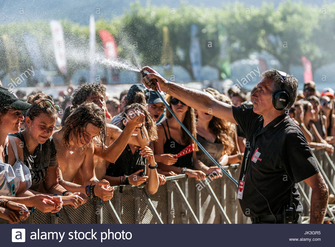 Security cooling the audience at Musilac summer festival - Stock Image