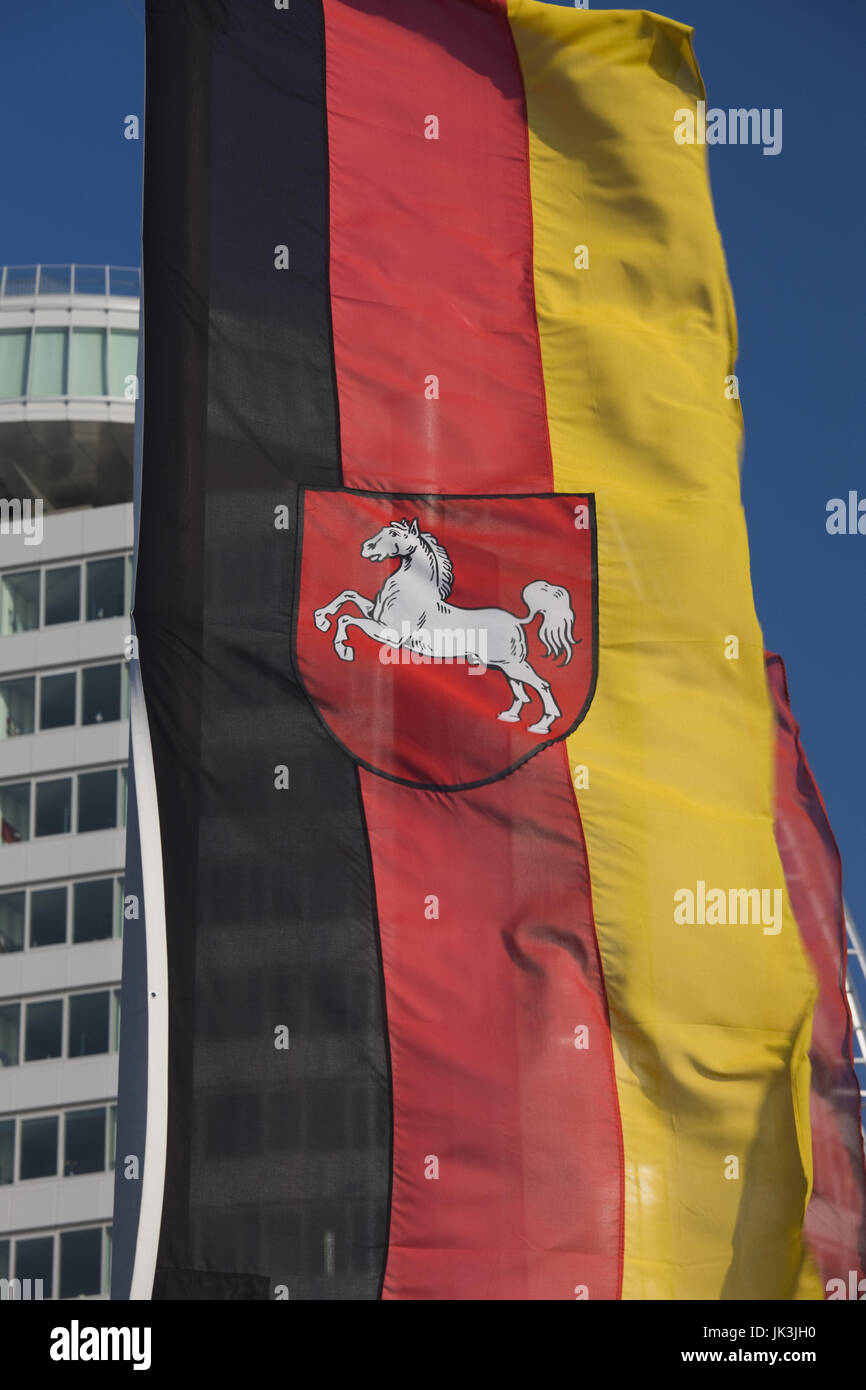 Germany, State of Bremen, Bremerhaven, Atlantic Sail City Building and Niedersachsen state flag, - Stock Image