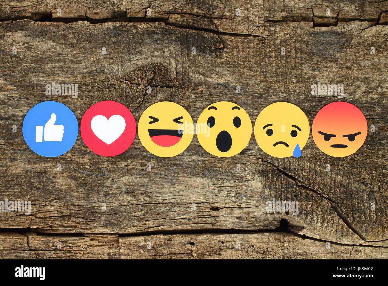 Kiev, Ukraine - February 07, 2017: Facebook like button 6 Empathetic Emoji Reactions printed on paper and placed - Stock Image