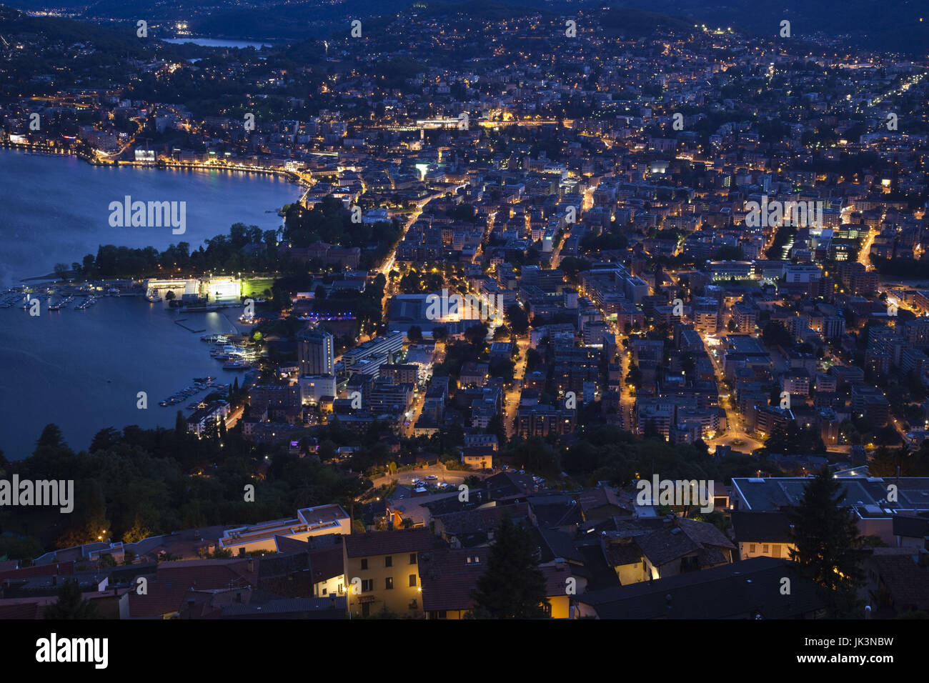 Switzerland, Ticino, Lake Lugano, Lugano, town view from Monte Bre, dusk Stock Photo