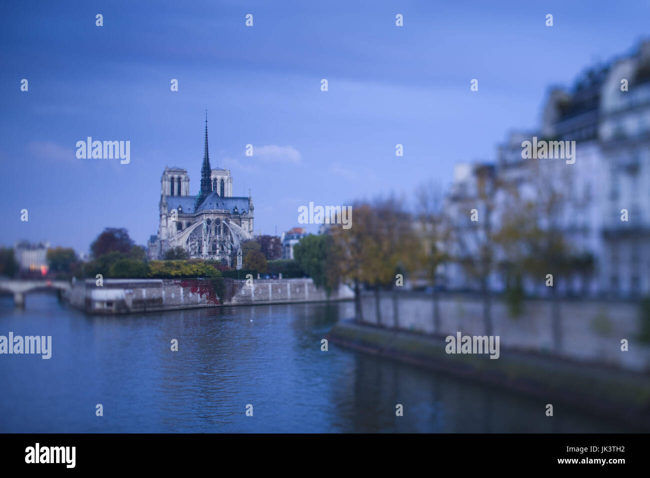 France, Paris, Notre-Dame cathedral and Ile St-Louis buildings, dawn, defocussed - Stock Image