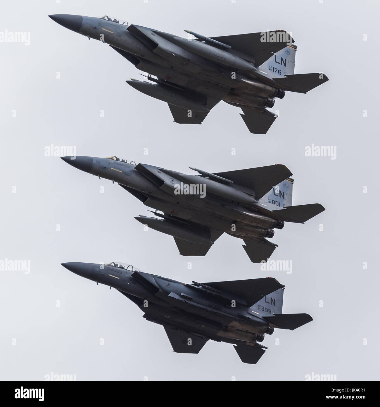 A pair of USAF F-15C Eagles seen flying in tight formation with an F-15E Strike Eagle during the 2017 Royal International Stock Photo