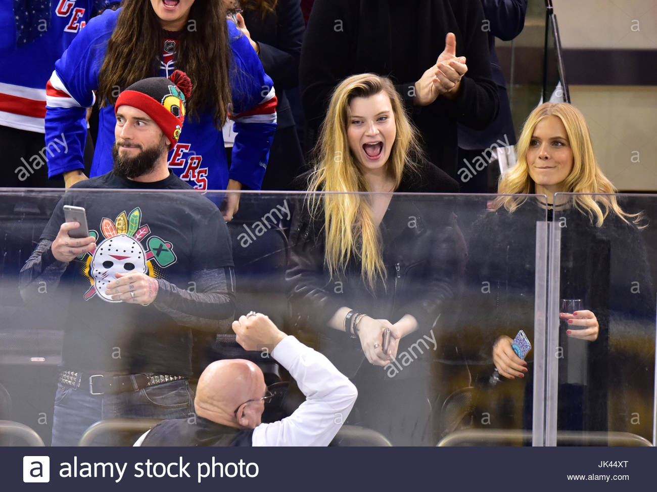 Cm Punk And Lizzy Glynn Celebrities Attend Vancouver Canucks Vs New York Rangers Hockey Game At Madison Square Garden In New York City