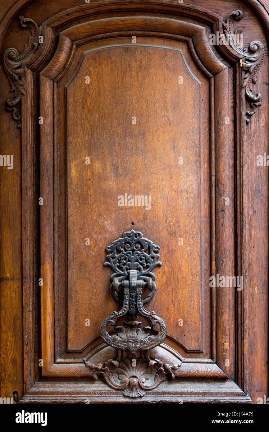 Old ornate door knocker in the Marais district, Paris, Ile-de-France, France - Stock Image
