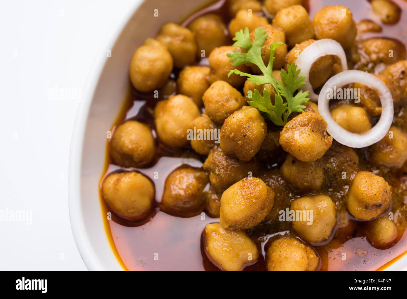 Chickpeas Masala - Chole masala curry ,traditional north indian lunch, dinner menu served in a ceramic bowl, selective - Stock Image