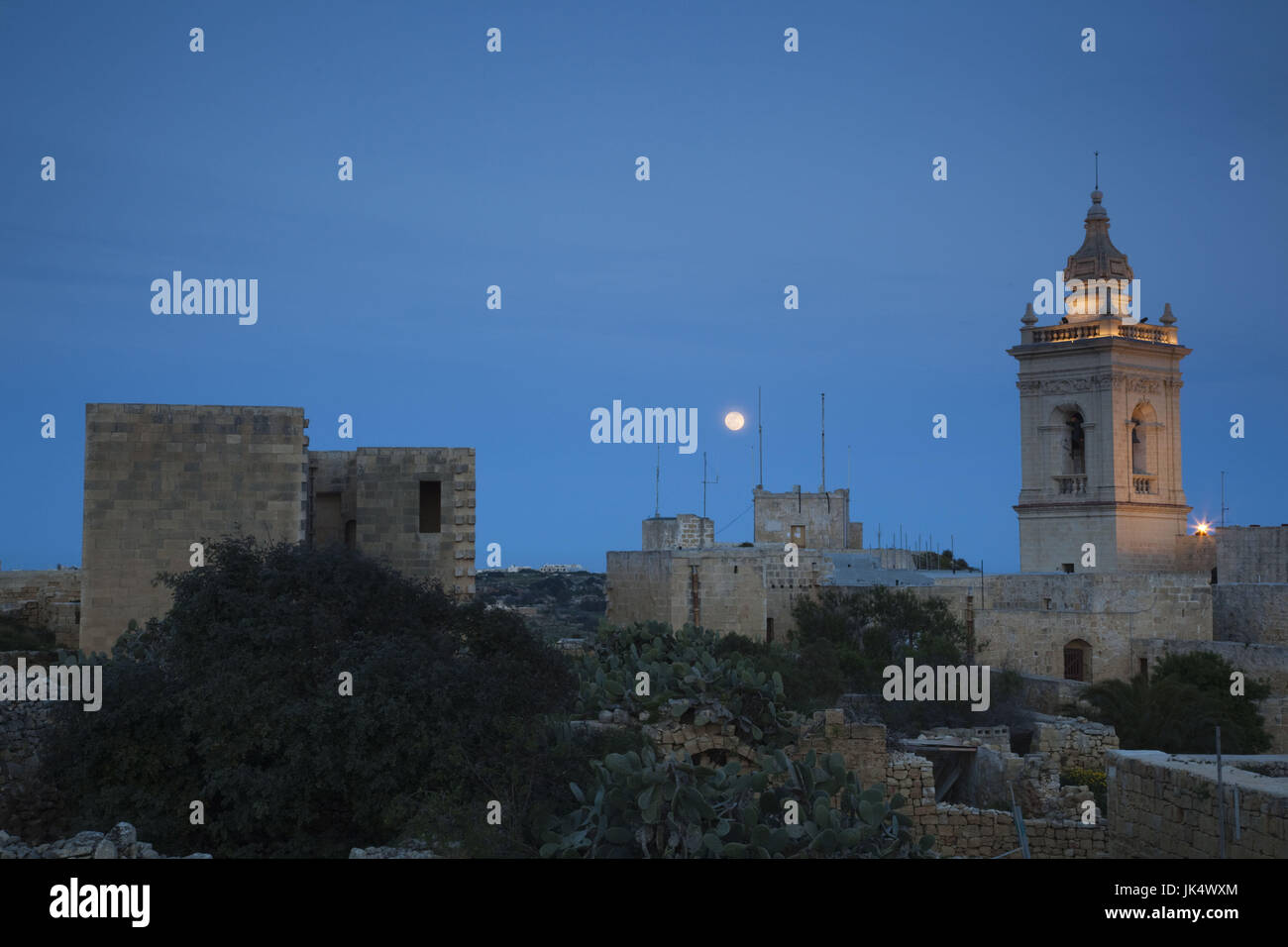 Malta, Gozo Island, Victoria-Rabat, Il-Kastell fortress, tower of Cathedral of the Assumption and moonrise - Stock Image