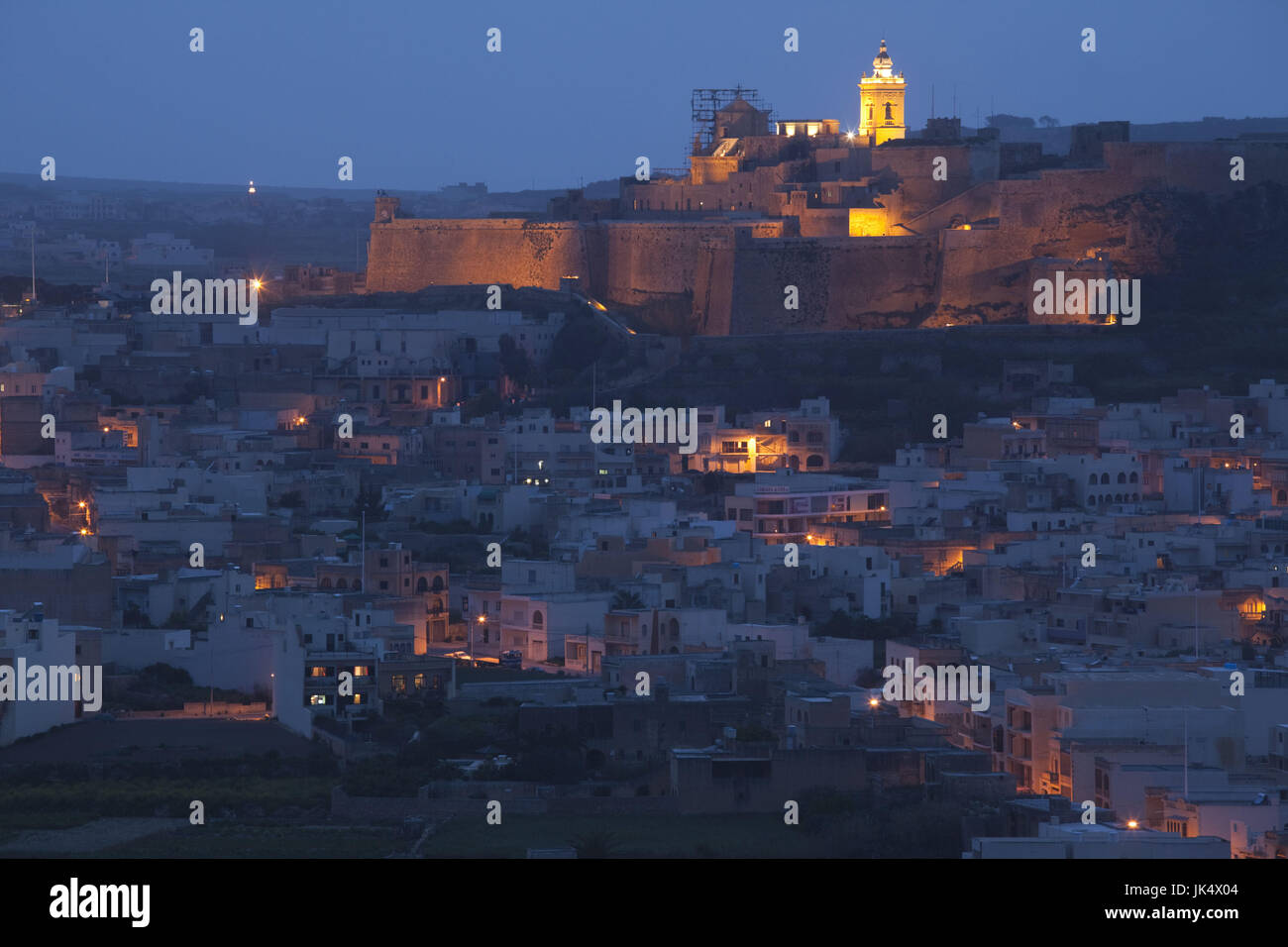 Malta, Gozo Island, Victoria-Rabat, elevated view of town and Il-Kastell fortress, dusk - Stock Image
