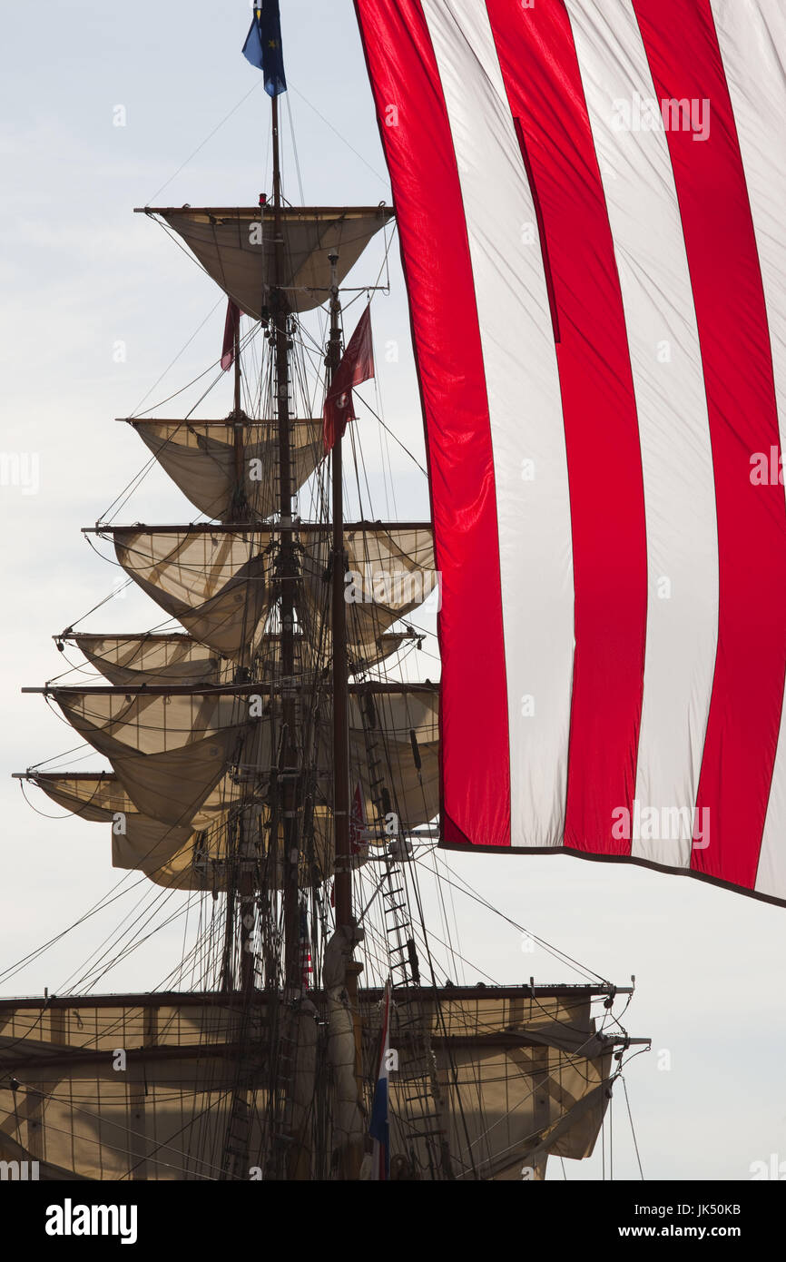 USA,Massachusetts, Boston, Sail Boston Tall Ships Festival, Dutch barque Europa, masts, and US flag, Rowes Wharf - Stock Image