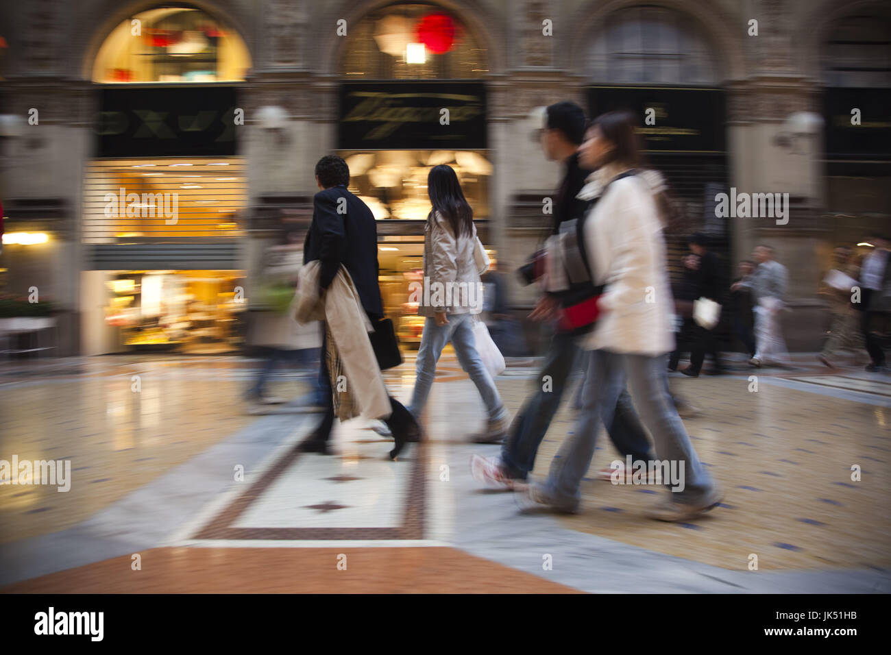 Italy, Lombardy, Milan, Galleria Vittorio Emanuele II, strolling shoppers, motion-blur, NR - Stock Image