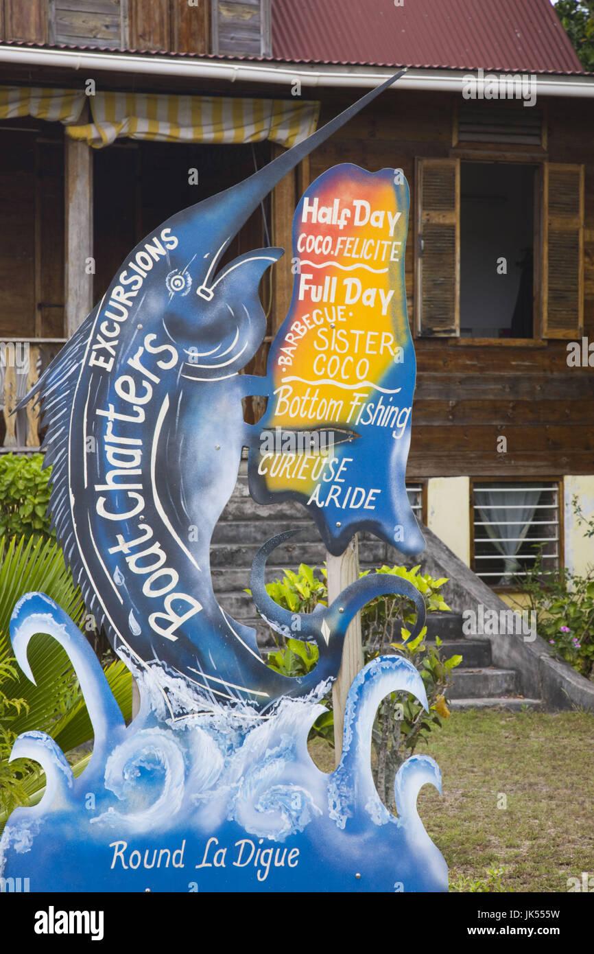 Seychelles, La Digue Island, La Passe, boat charter sign - Stock Image