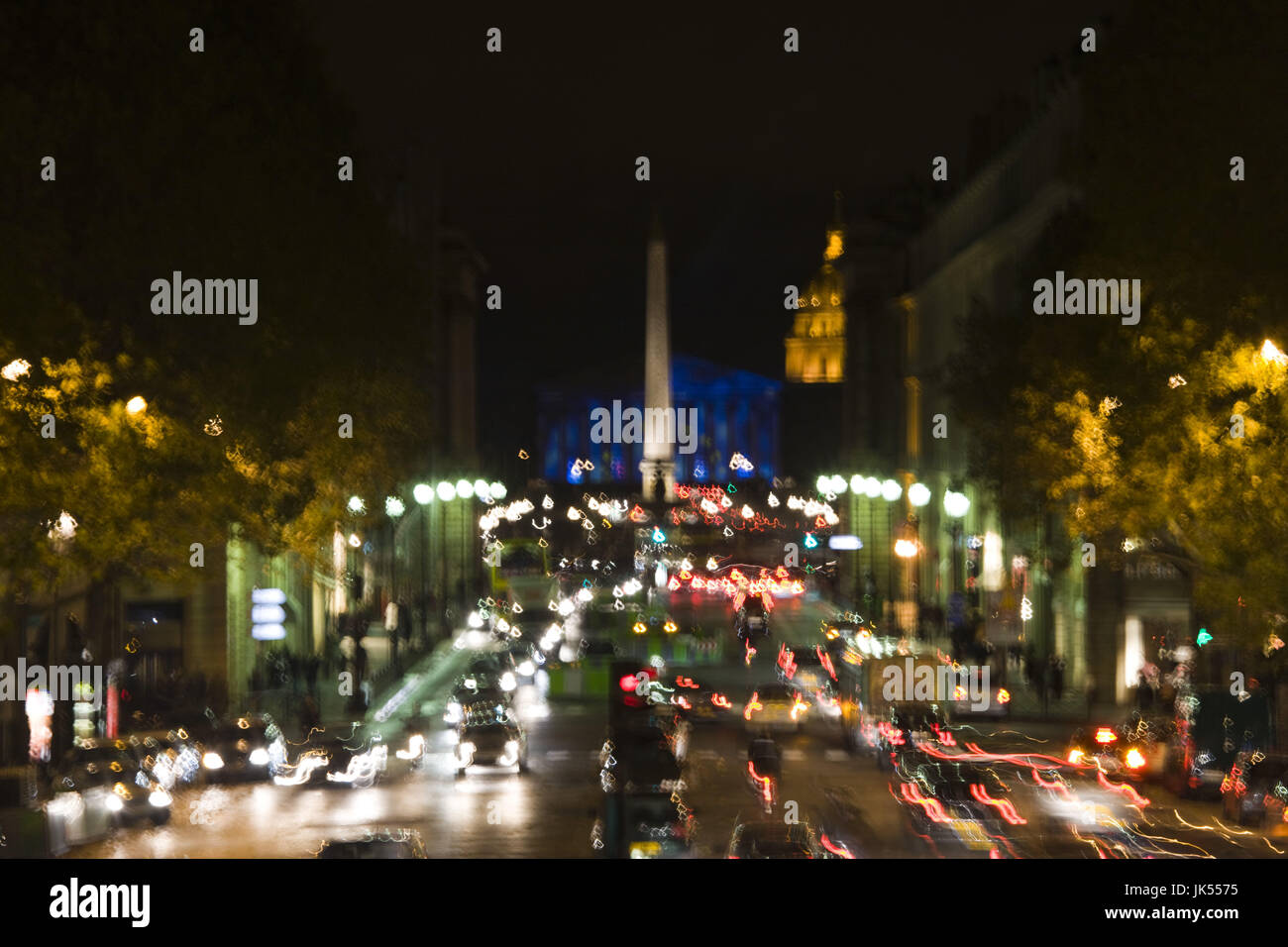 France, Paris, traffic on Rue Royal from Ste-Marie Madeleine church, evening, motion-blur - Stock Image