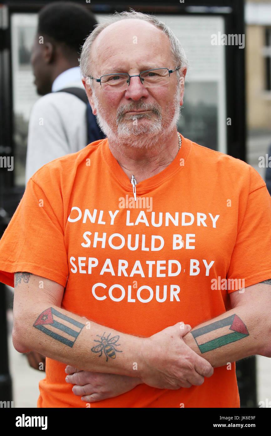 man in an orange shirt uk version