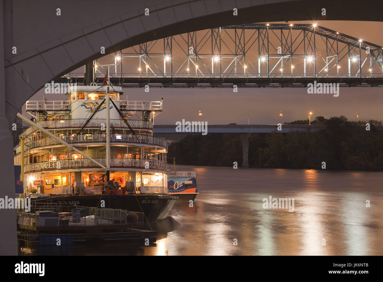 USA, Tennessee, Chattanooga, Delta Queen riverboat and Tennessee River bridges, dusk - Stock Image