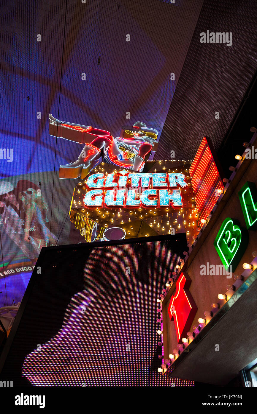 USA, Nevada, Las Vegas, Downtown, Fremont Street Experience, Sassy Sally neon sign for Glitter Gulch strip club - Stock Image