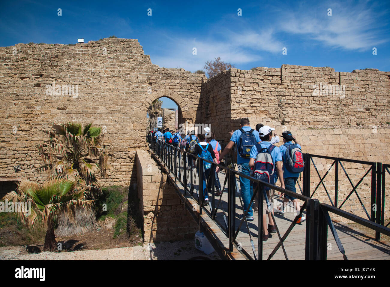 Israel, North Coast, Caesarea ruins of port built by Herod the Great in 22 BC, schoolchildren, NR - Stock Image