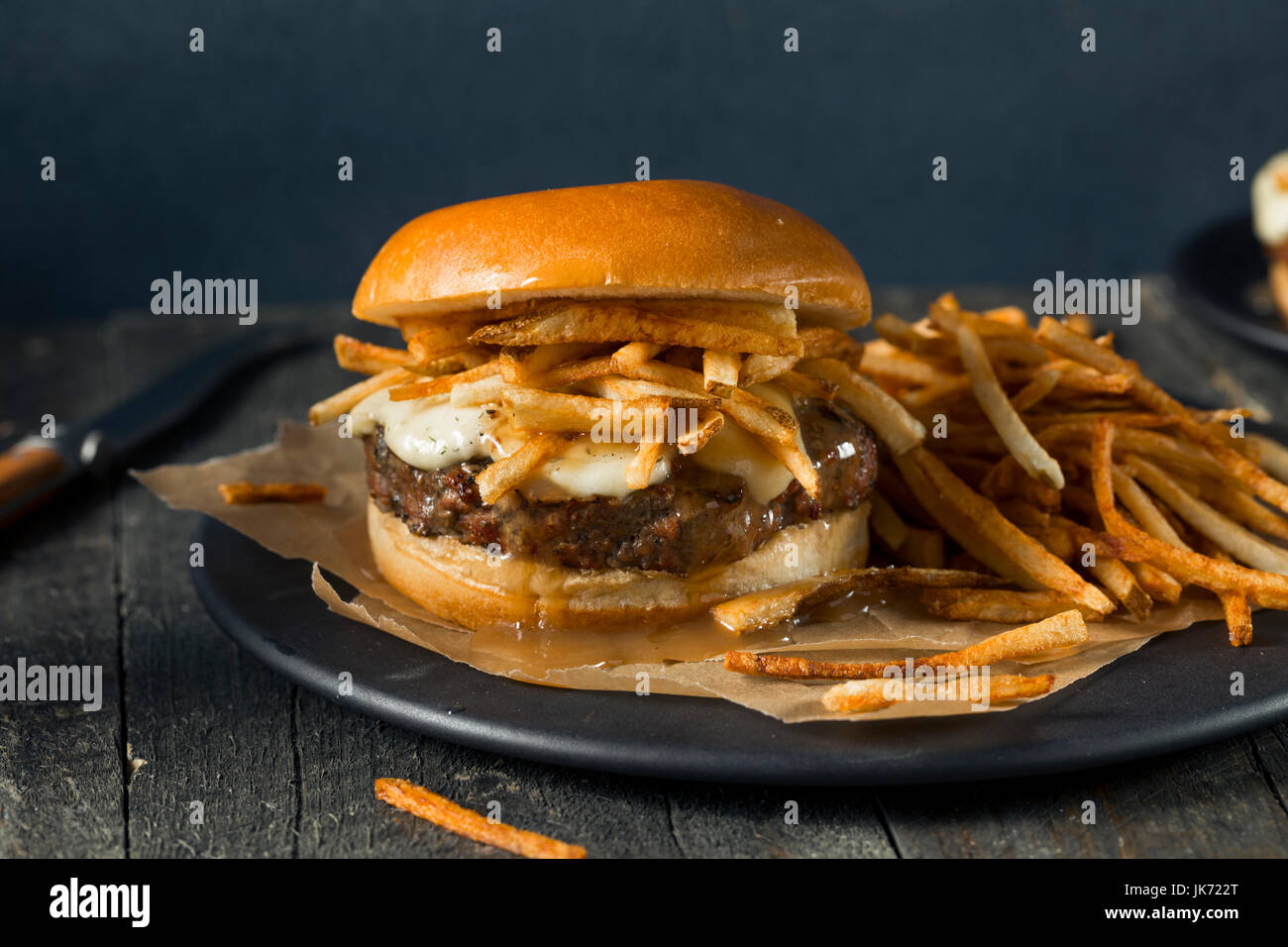 Homemade Poutine Hamburger with Fries Gravy and Cheese Curds - Stock Image