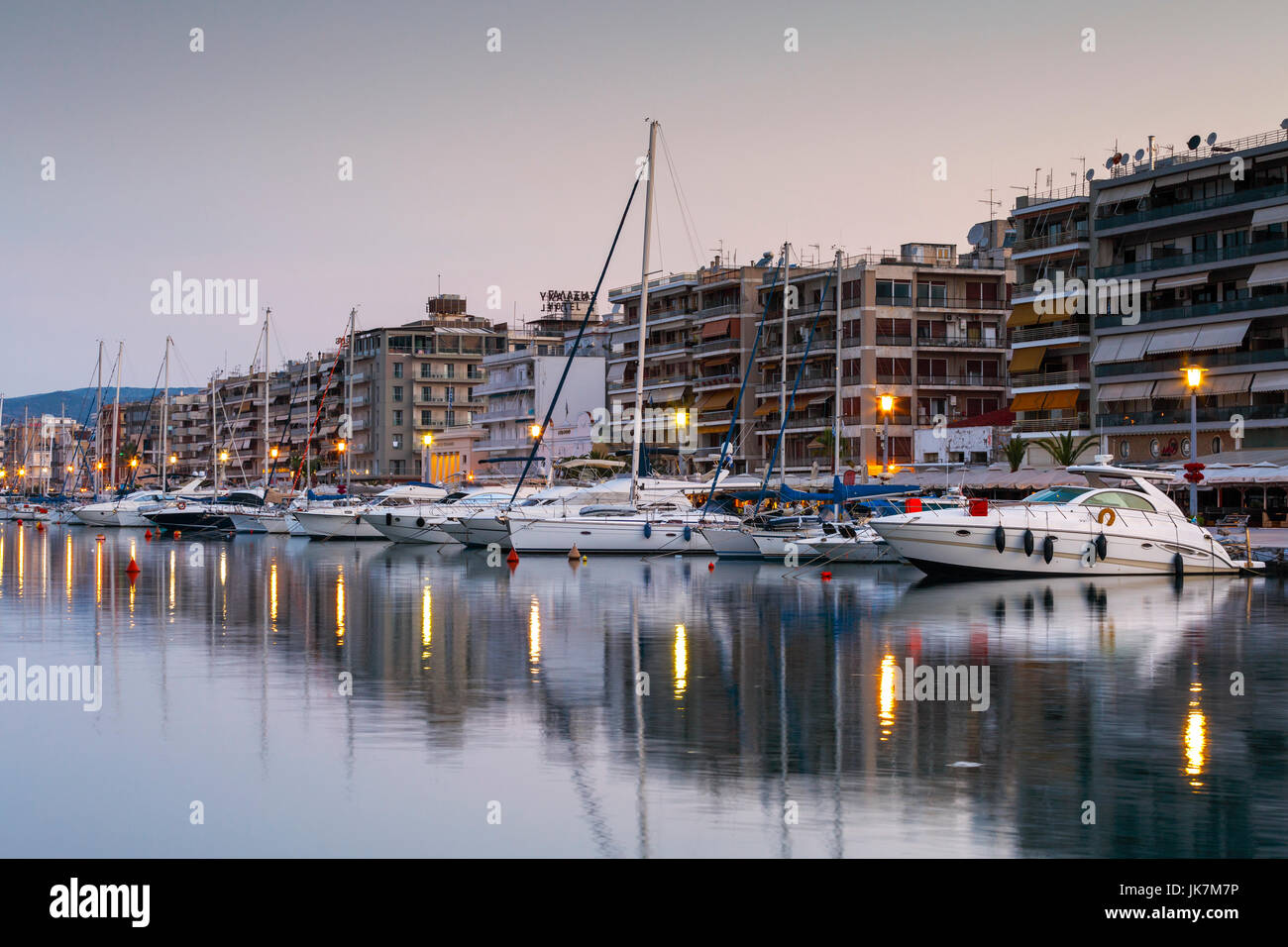 Sail boats in the harbour of Volos city as seen early in the morning. - Stock Image