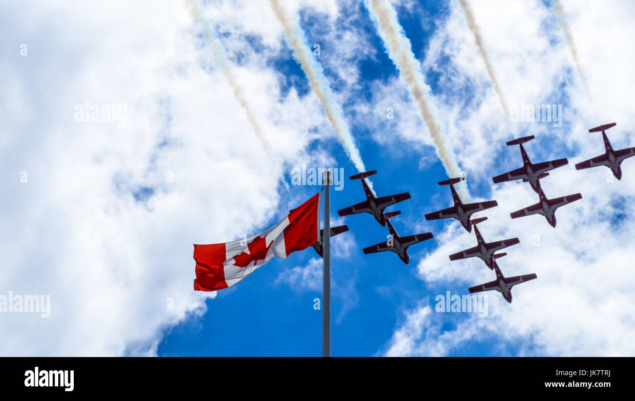 The CF Snowbirds flypast over the flag of Canada on the Canada Day in Ottawa Stock Photo