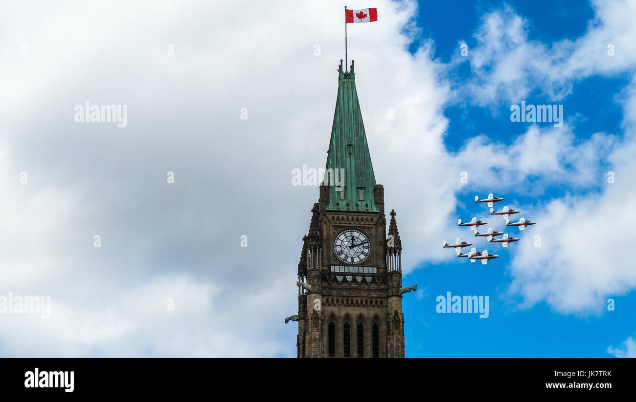 The Canadian Forces (CF) Snowbirds flypast the Peace Tower on the Parliament Hill to celebrate Canada Day, Ottawa, Stock Photo