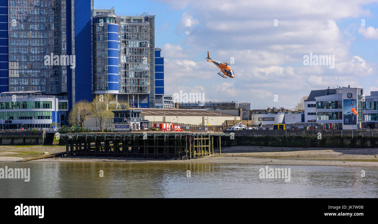 Helicopter taking off by River Thames - Stock Image