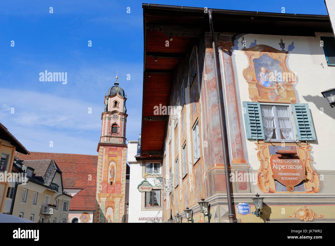 Restaurant 'Alpenrose' with paintings and parish church St. Peter and Paul, Mittenwald, Werdenfelser Land, - Stock Image