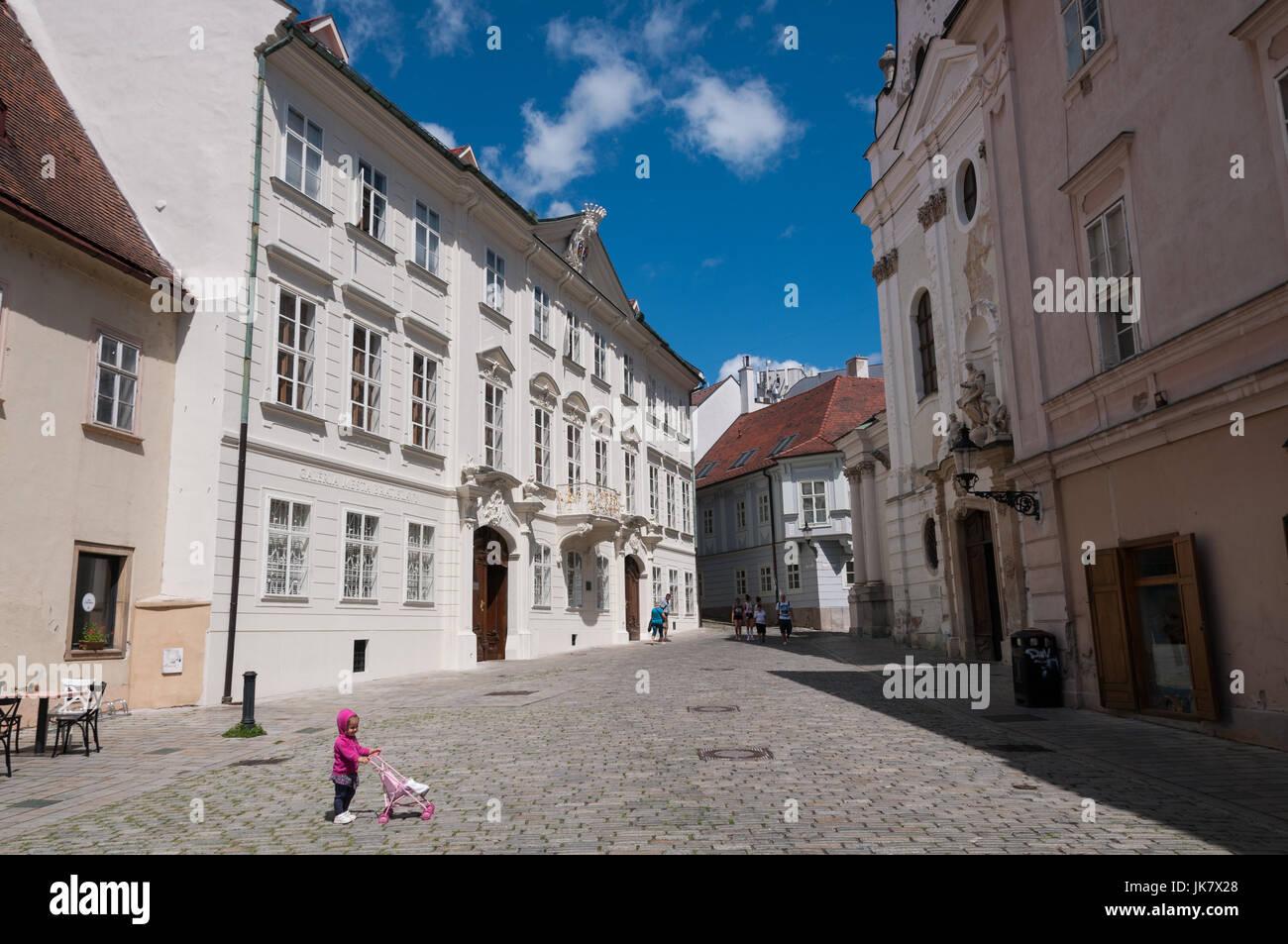 Mirbach Palace (Bratislava City Gallery) on the left, Franciscan Church on the right, Bratislava Slovakia - Stock Image