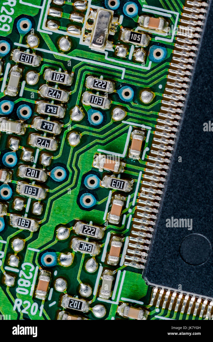 surface mount technology (smt) components on a green printed circuit board   interconnected concept  wiring inside computer
