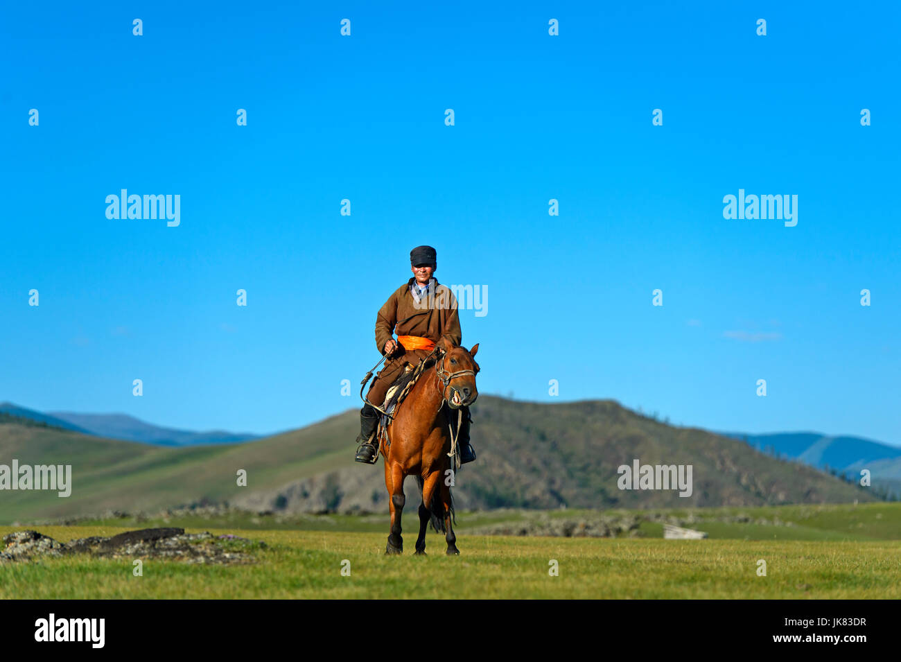 Horseman in the steppe, Orkhon Valley, Mongolia - Stock Image