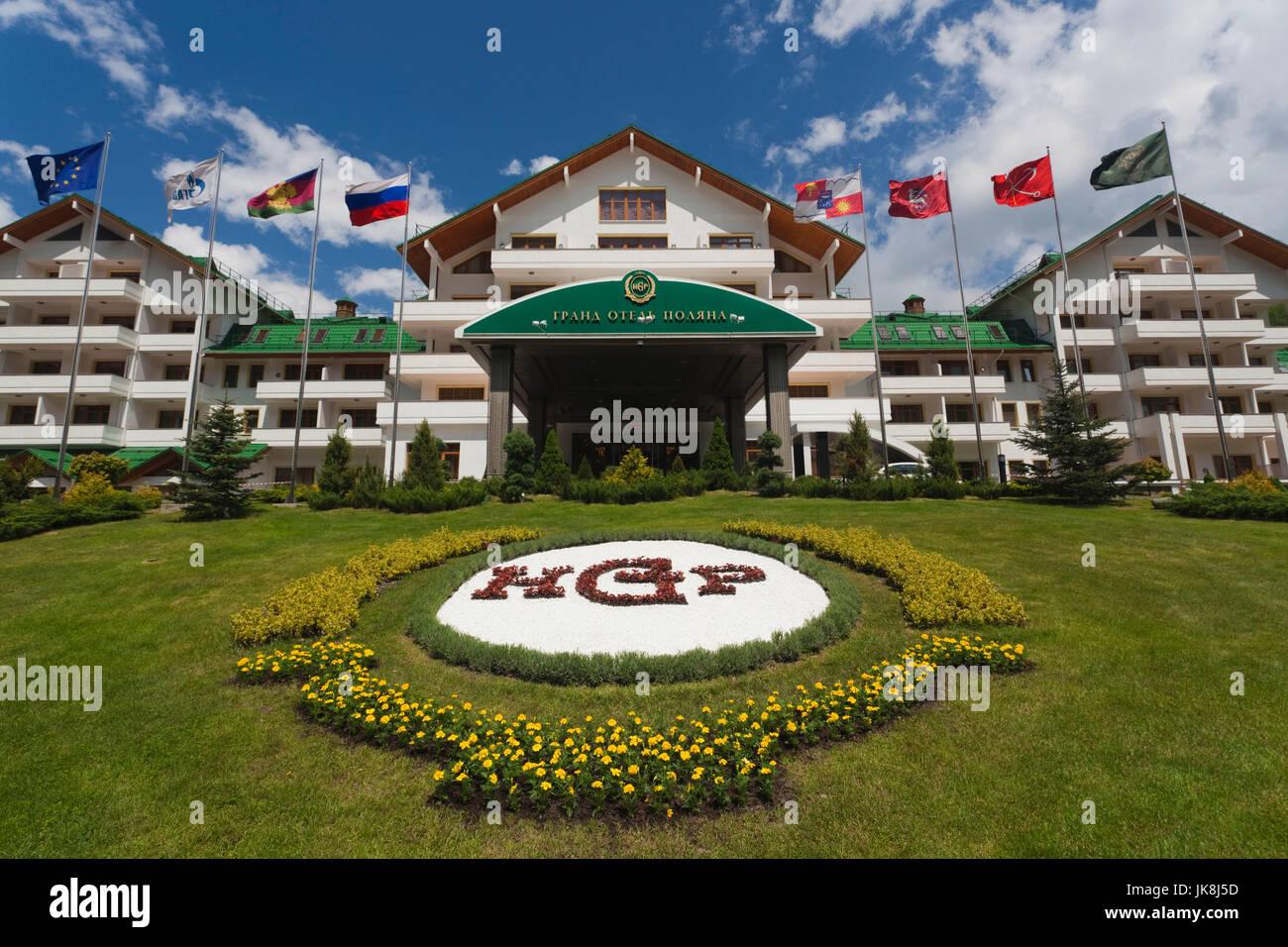Russia, Caucasus Mountains, Sochi Area, Krasnaya Polyana, Gazprom Ski Resort, Grand Hotel Polyana, exterior, summer - Stock Image