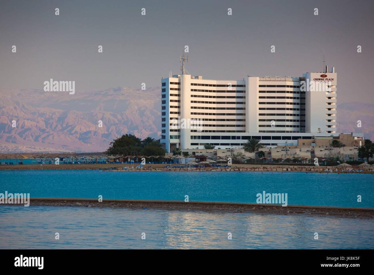 Israel, Dead Sea, Ein Bokek, Dead Sea resort hotels, dusk - Stock Image