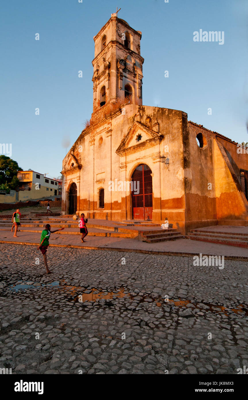 Children playing in front of ruins of Church Iglesia de Santa Anna in Trinidad Cuba; - Stock Image