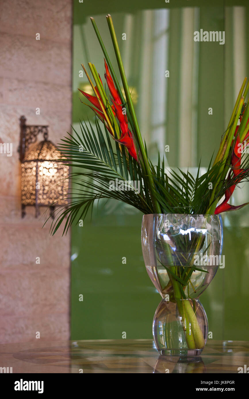 Jordan, Aqaba, hotel interior, traditional lamp and heliconia flower - Stock Image