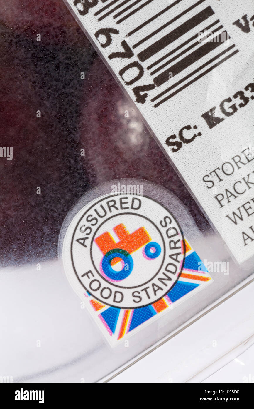Assured Food Standards logo with little red tractor on pack of cherries - Stock Image