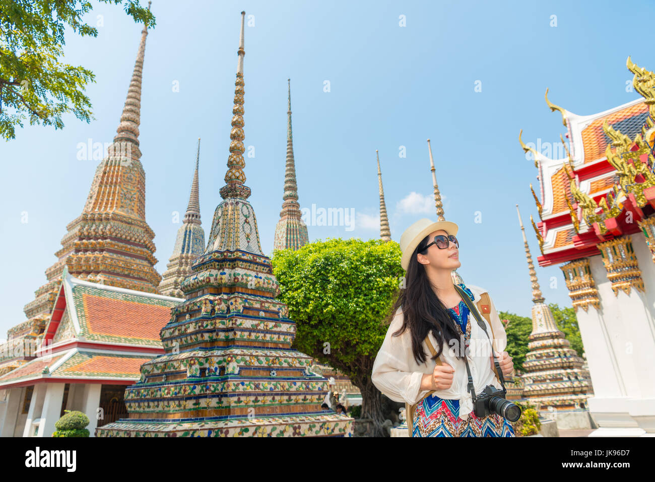 8a533f9d80 Bangkok city asian chinese woman enjoying view of wat pho temple shrine  living a happy lifestyle