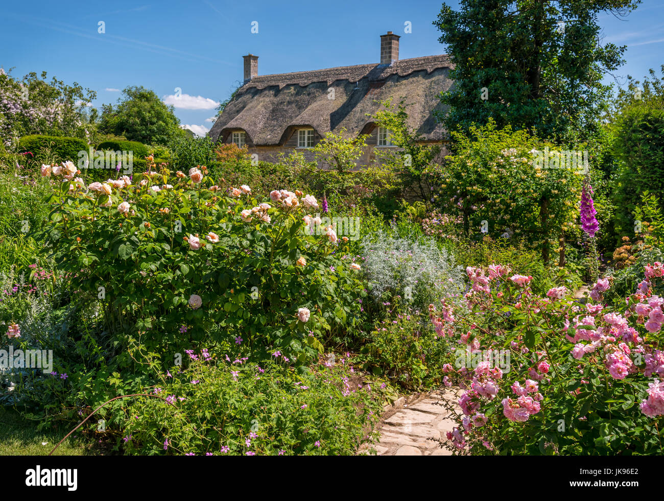 Typical 'English Country Garden' with country cottage - Stock Image
