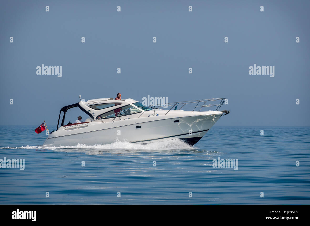 Jeanneau Prestige 34 motor yacht at speed on a sunny day - Stock Image