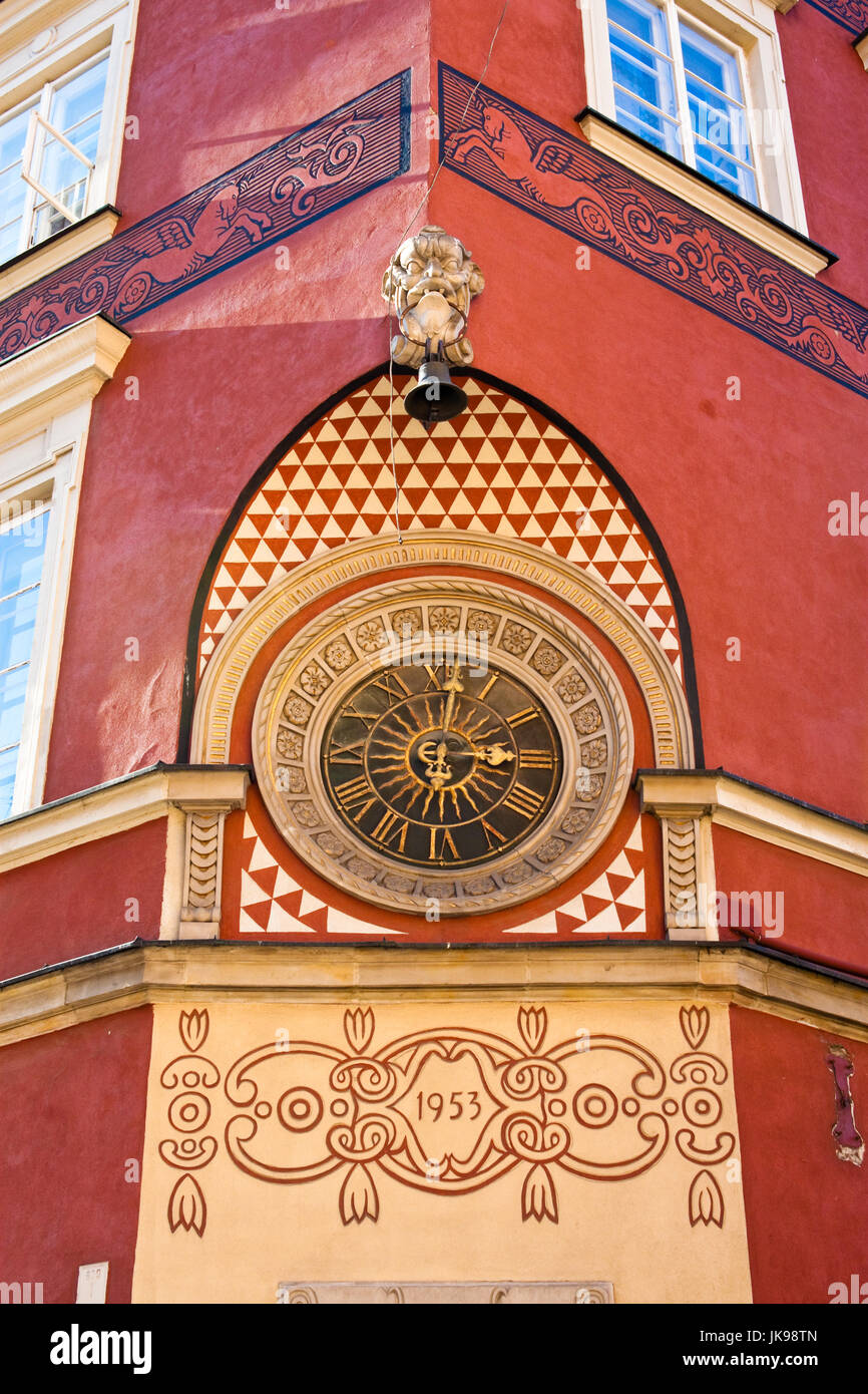 Old clock on the wall at the Market square in the old town of Warsaw, Poland. - Stock Image