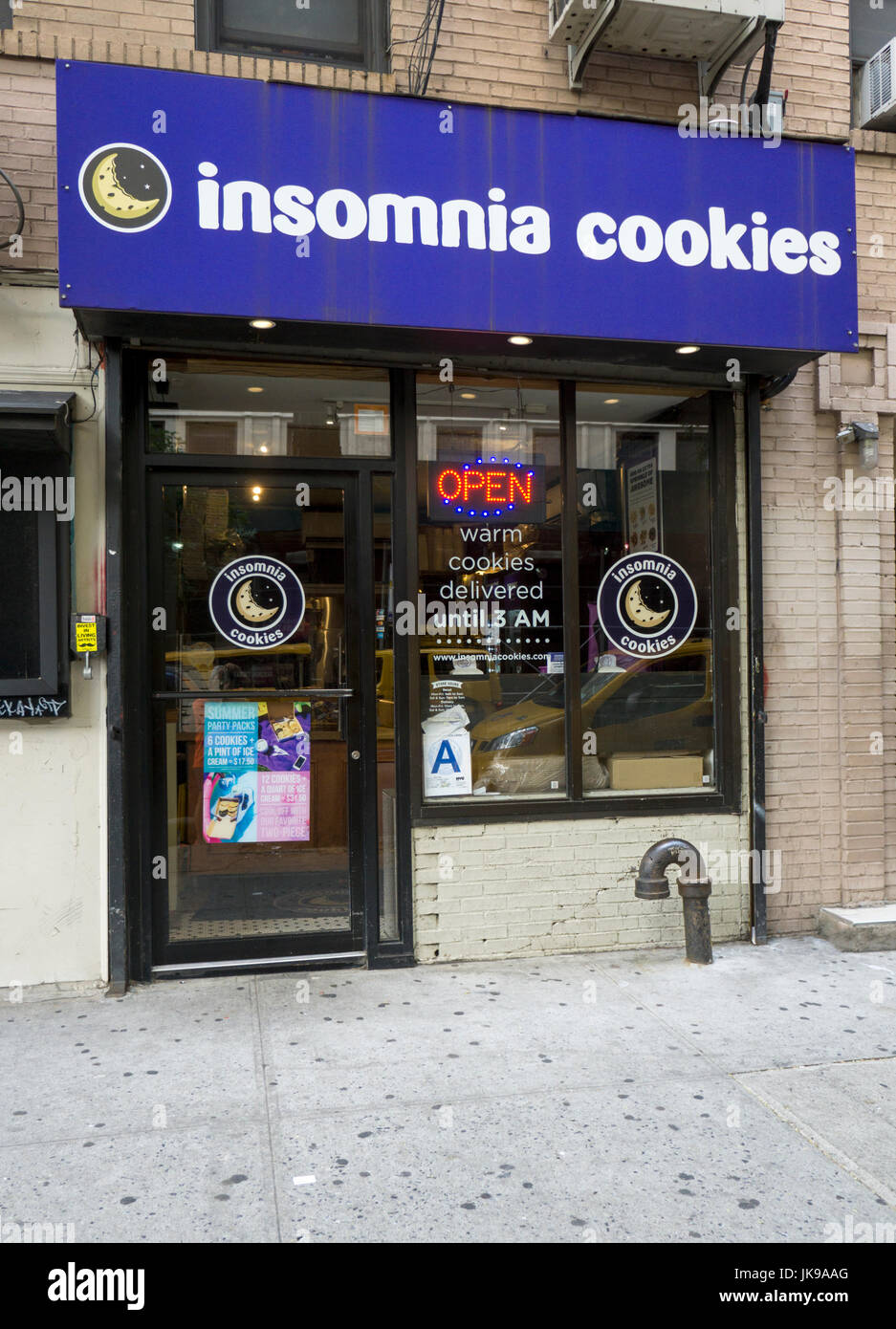 The exterior of Insomnia Cookies, a bakery in the East Village that specializes in delivering warm cookies until - Stock Image