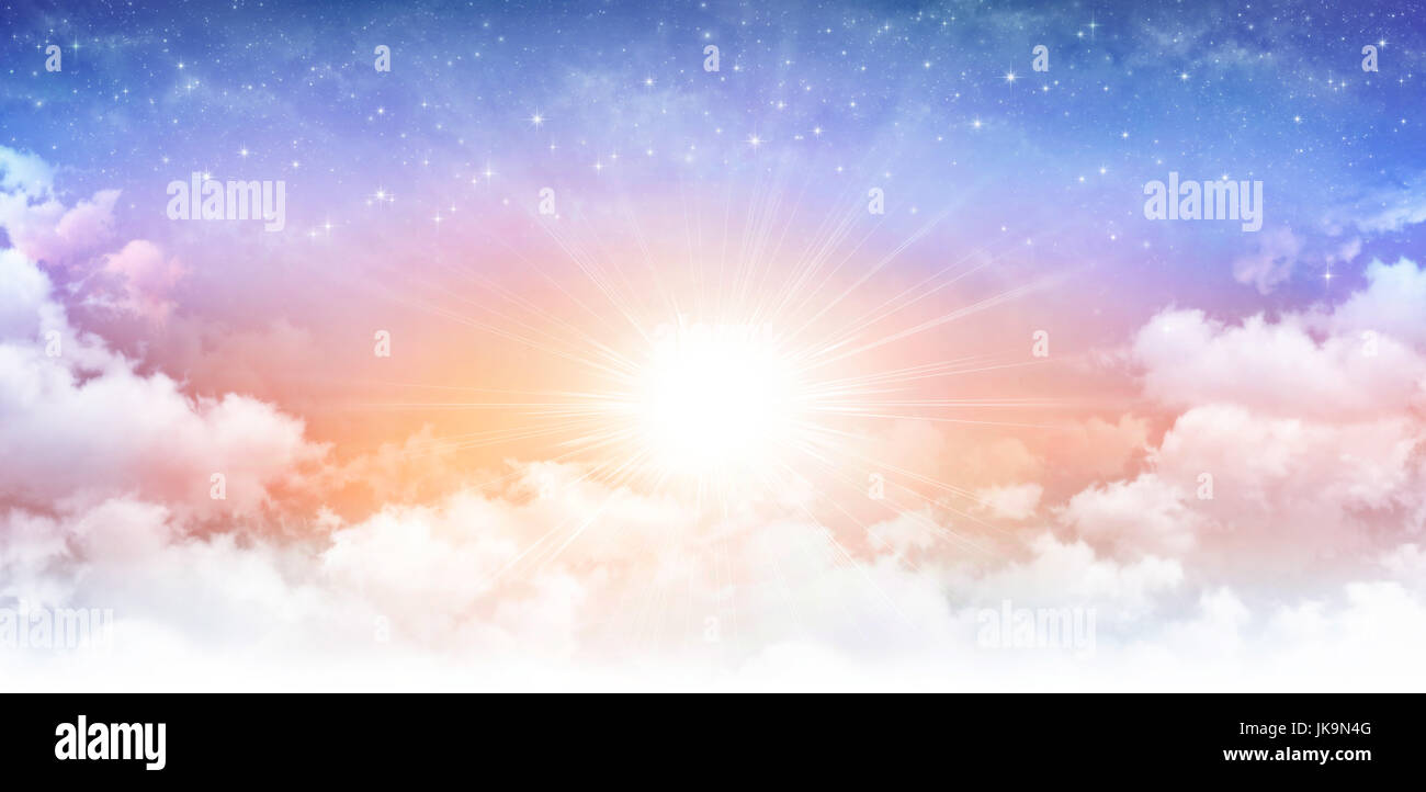 Heavenly sky, sun breaking through white clouds and stars shining behind. - Stock Image