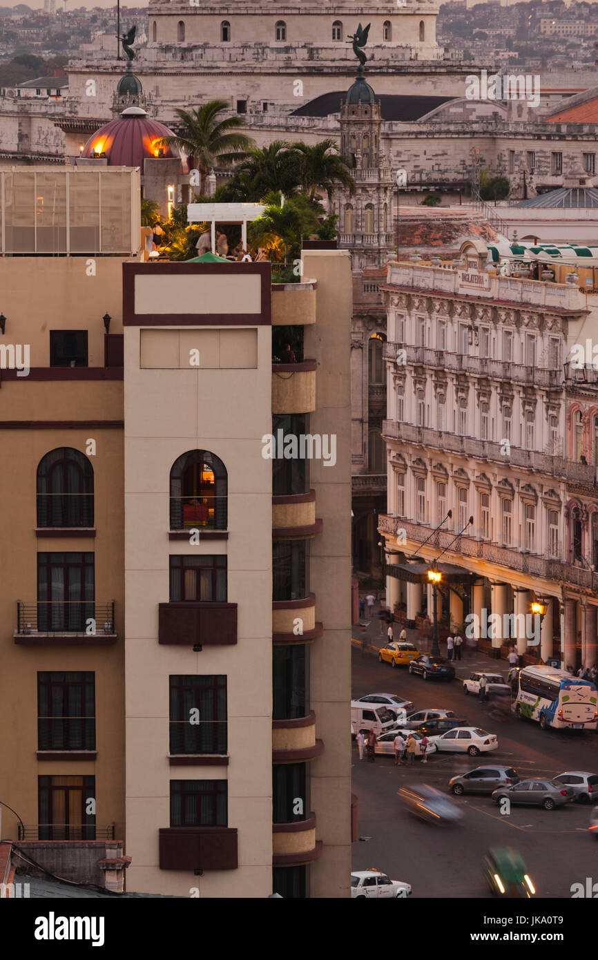 Cuba, Havana, elevated view of Hotel Parque Central and Hotel Inglaterra, dusk - Stock Image